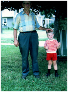 With my grandfather in front of the house on Fourth Street