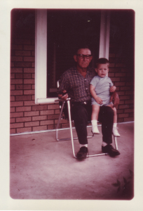 With my grandfather on the front porch